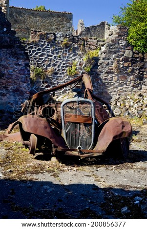 Frontal vertical view of a rusty old car.  Abandoned rusty old car.  - stock photo