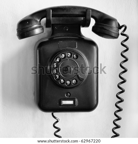 Frontal view of a vintage black wall telephone - stock photo