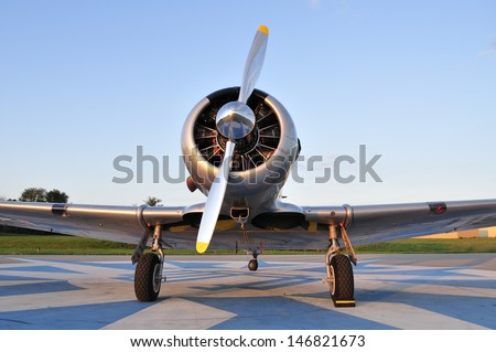Frontal view of a vintage WWII training aircraft  - stock photo