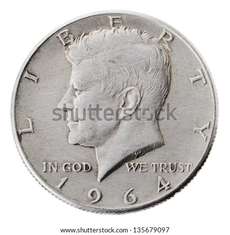 Frontal view of the obverse (heads) side of a silver half Dollar minted in 1964.Depicted is a profile portrait of John F. Kennedy and comes to honor his memory. Isolated on white background. - stock photo