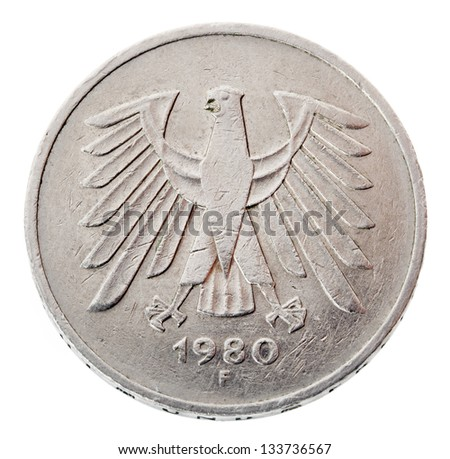 Frontal view of the reverse (tails) side of a a 5 Deutsche Mark (DM) coin minted in 1980. Depicted is the German coat of arms - the German eagle. Isolated on white background. - stock photo