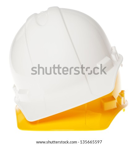 Frontal view of two hard hats, white on top of yellow, isolated on white background. - stock photo