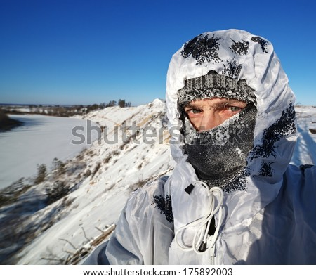 Frost on the frozen face and clothes men. - stock photo