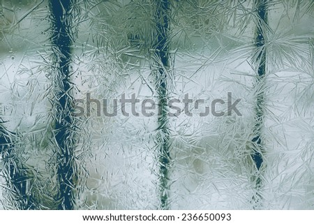 frost on the glass window abstract background is selective soft focus toned photo winter christmas - stock photo