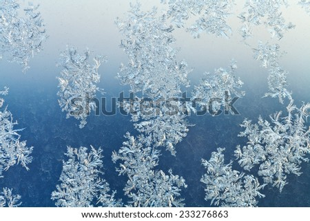 frost on window glass close up in cold winter night - stock photo