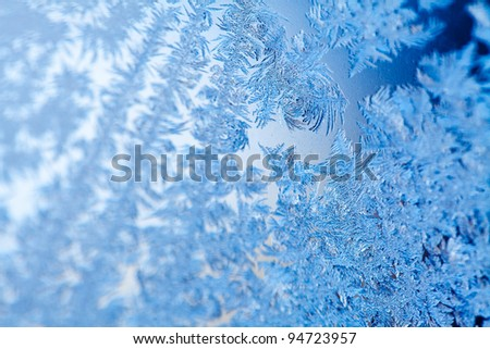 Frost patterns on window glass - stock photo