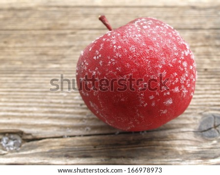frosted apple on a board - stock photo