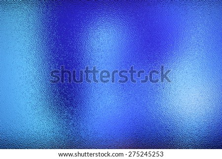 Frosted glass texture. Blue lights background. - stock photo