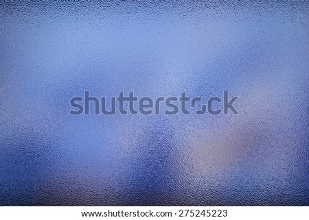 Frosted glass texture. Colorful lights background. - stock photo