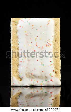 Frosted Pastry tart on a black background - stock photo