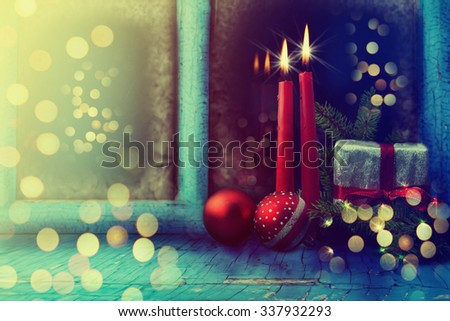 Frosted window with Christmas decoration. - stock photo