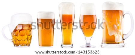 Frosty fresh beer collection with foam isolated background - stock photo