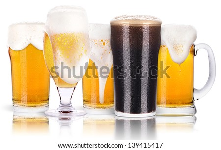 Frosty glass of dark  and light beer set isolated on a white background - stock photo