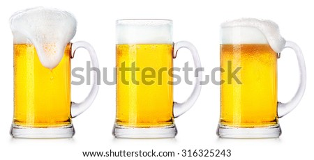 Frosty glasses of light beer isolated on a white background - stock photo