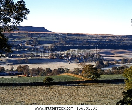 Frosty morning view of hills and village, Wensleydale, Yorkshire Dales, North Yorkshire, England, UK, Great Britain, Western Europe. - stock photo