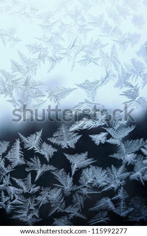 Frosty natural pattern at a winter window glass - stock photo