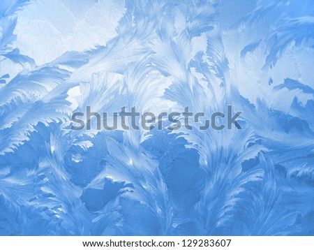 Frosty natural pattern on winter window - stock photo