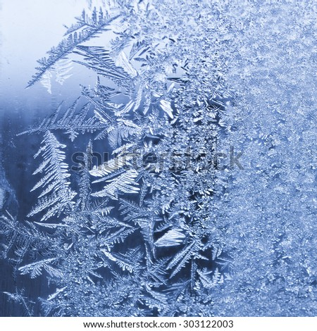 Frosty winter background photo of ice buildup on a window - stock photo