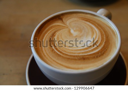 Frothy Cappuccino at Breakfast - 1 - stock photo