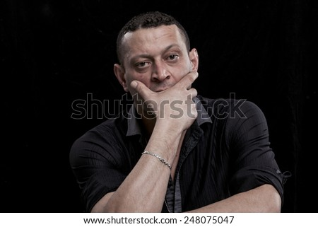 Frowning and thoughtful man portrait - stock photo