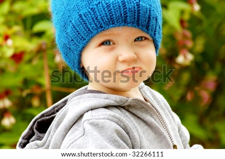Frowning Little Boy - stock photo