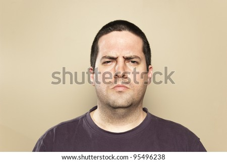 Frowning man - stock photo