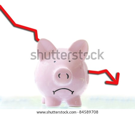 frowning pink piggy bank with down arrow, on white - stock photo