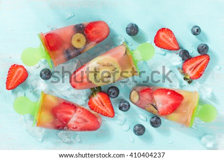 Frozen and iced fruit - strawberry,kiwi, blueberry and coconut water, selective focus - stock photo