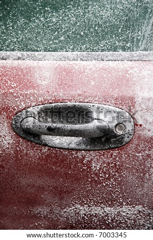 Frozen car after a winter blizzard with copy space for text - stock photo