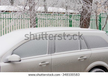 frozen car window closeup snow crystals and ice - stock photo