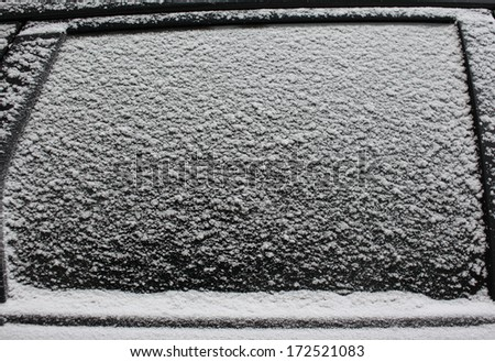 Frozen car window, texture freezing ice glass background - stock photo