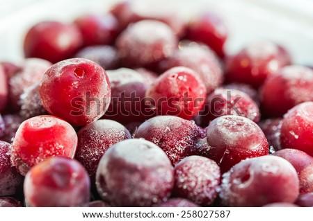 Frozen cherry berries. Macro image with small depth of field. Beautiful berries background - stock photo