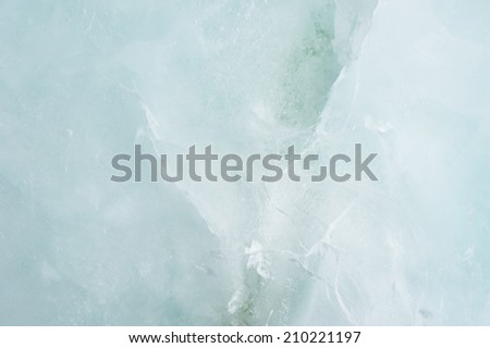frozen colored ice texture to use as background ot texture - stock photo