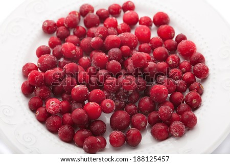 frozen cranberries on a plate - stock photo