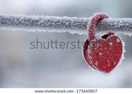 frozen heart-shaped lock, symbol of love - stock photo