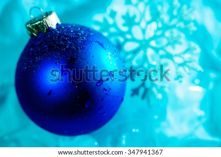 frozen ice ball decoration with snowflake and water drops close up - stock photo