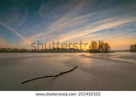 frozen lake at sunrise landscape - stock photo