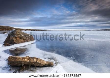 Frozen lake in South Iceland.Close to Reykjavik city/Frozen Lake - stock photo