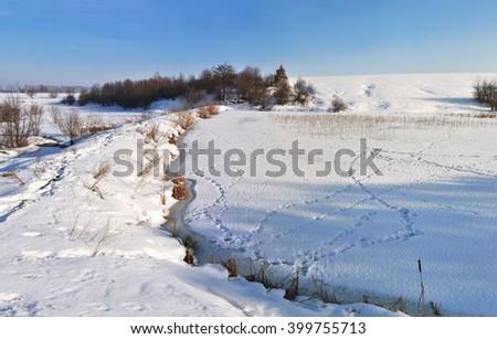 frozen lake with snow - stock photo