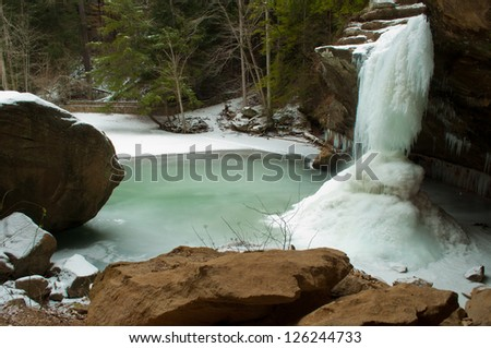 Frozen lower falls at Old Man Cave in the Hocking Hills in southern Ohio. - stock photo