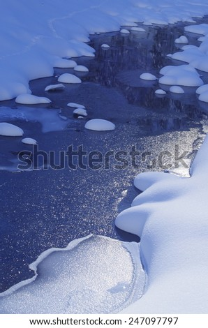 Frozen mountain river, with snow. - stock photo