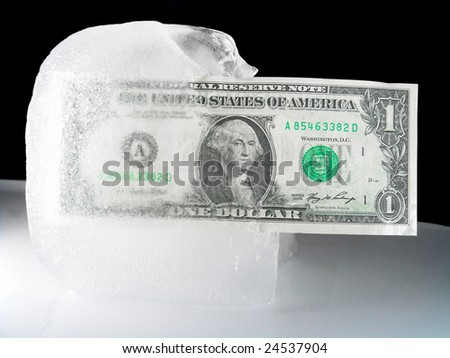 Frozen or Thaw Economy (US Currency) - stock photo