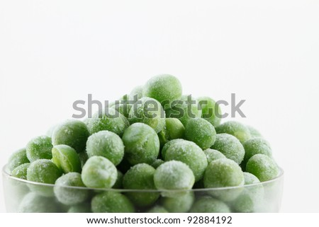 Frozen peas in small glass - stock photo