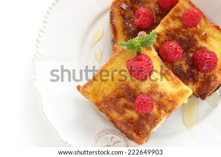 frozen raspberry on french toast for gourmet breakfast image - stock photo