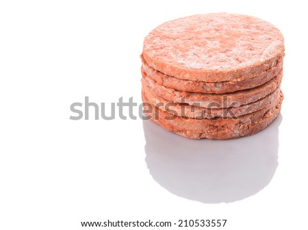 Frozen raw hamburger beef meat over white background - stock photo