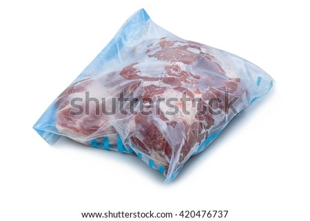 frozen raw pork wrapped in plastic bag on a white background - stock photo