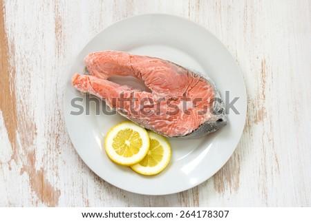 frozen salmon and lemon - stock photo