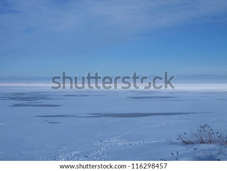 Frozen sea surface with some thawed areas - stock photo