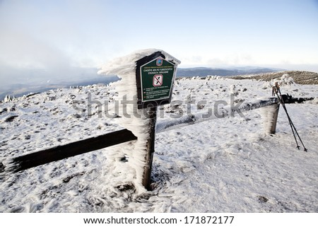 Frozen sign in Czech mountains - stock photo