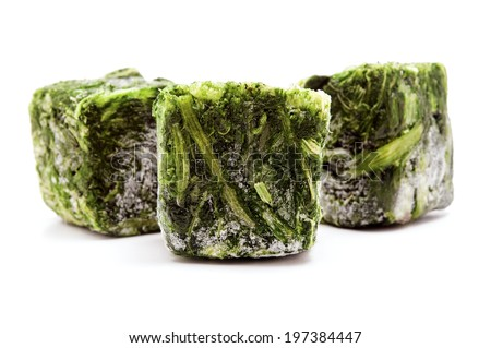 Frozen spinach cubes on a white background - stock photo